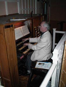 John playing the Organ